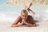 Sexy blond girl posing on a sand beach — Foto de Stock