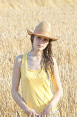 Portrait of beautiful girl in wheat field — Stock Photo
