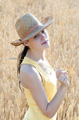 Beautiful young girl on wheat field — Stock Photo