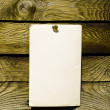 Royalty-Free Stock Photo: Old paper on wood panel