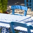 Detail of traditional Greek tavern blue tables and chairs — Stock Photo