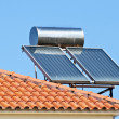 Solar panel on a red roof — Stock Photo #8701683