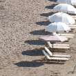 Stock Photo: Sunbeds on beach in row