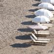Sunbeds on beach in row — Stock Photo #8701708