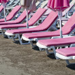 Stock Photo: Pink sunbeds at beach