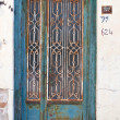 Traditional blue Greek door — Stock Photo