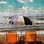 Retro photograph of sunbeds at sand beach — Stock Photo #8703732