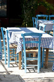 Greek restaurant with traditional blue table and chairs — Stock Photo
