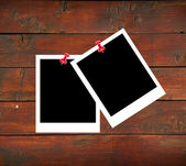 Blank photo papers on wooden background — Stock Photo