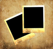 Grunge paper and blank vintage photos — Stock Photo