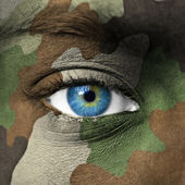 Army camouflage on human face — Stock Photo