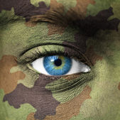 Military colors on human face — Stock Photo