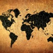 Antique world map on grunge cracked paper — Stock Photo