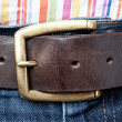 Jeans leather belt and shirt detail — Stock Photo