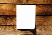 Blank paper on wooden background — Stock Photo