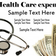 Foto Stock: Stethoscope and money - Health Care concept