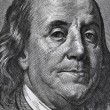 Stock Photo: Extreme macro of 100 dollar bill with Benjamin Franklin portrait