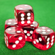 Set of gambling dices on green background — Stock Photo