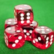 Set of gambling dices on green background - Stock Photo