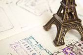 Stamped passport with Eiffel passport - travel to Paris concept — Stock Photo