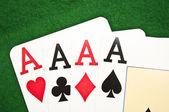 Four aces macro shot on green background — Stock Photo