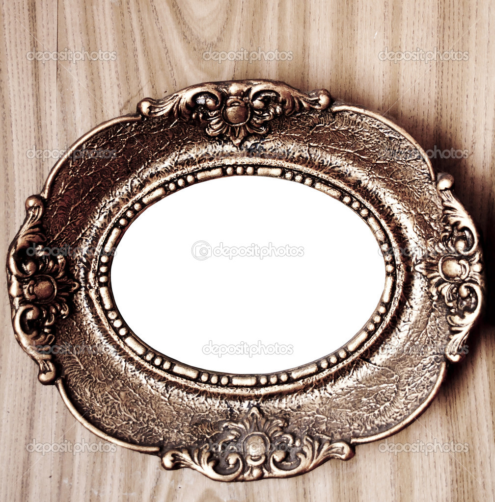 Empty golden vintage frame on wooden wall — Stock Photo #9328744