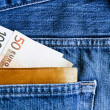 Wallet with euros in jeans pocket — Stock Photo