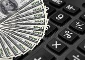 калькулятор и долларов - расходы концепции — Стоковое фото