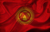 Kyrgyzstan waving flag — Stock Photo