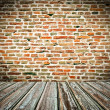 Old room with brick wall and wooden floor — Stock Photo