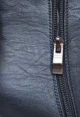 Zipper on black leather detail — Stock Photo