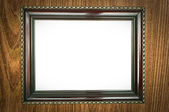 Antique wood frame on wooden background — Stok fotoğraf