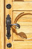 Wooden door with antique handle — Stock Photo