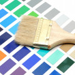 Brush with wood handle on color palette — Stock Photo #10080738