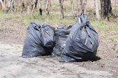 Pile of garbage on green grass in the nature environment problem — Stock Photo