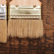 Brush on wood background texture — Stock Photo