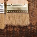 Brush on wood background texture — Stock Photo