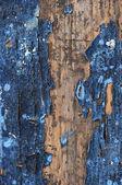 Obsolete weathered cracked painted wood grunge background — Stock Photo
