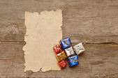 Colorful gifts on old paper — Stock Photo