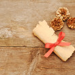 Stock Photo: Vintage paper roll with gold cones