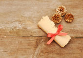Vintage paper roll with gold cones — Stock Photo