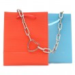 Shopping bags and chain with heart on white background — Stock Photo