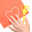 Red valentine heart and yellow scissor - 图库照片