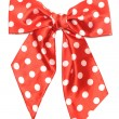 Dotted red satin gift bow isolated on white - 图库照片