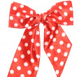 Dotted red satin gift bow isolated on white — Stock Photo #8670212