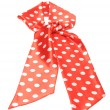 Dotted red satin gift bow isolated on white — Stock Photo #8670225