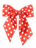 Dotted red satin gift bow isolated on white — Stock Photo