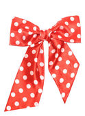 Dotted red satin gift bow isolated on white — Стоковое фото