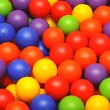 Colorful plastic balls on children's playground — Stockfoto