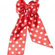Dotted red satin gift bow and ribbon isolated on white — Stock Photo